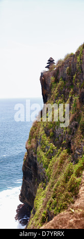 Ancient temple on a high cliff. Indonesia, Bali, Pura Luhur Uluwatu - Stock Photo