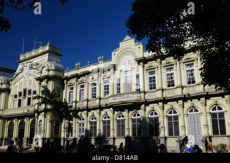 Main classic post office building in San Jose Costa Rica with morning sun and blue sky - Stock Photo