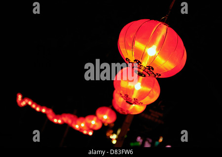 Chinese Lanterns glowing at night - Stock Photo