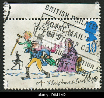 UK - CIRCA 1993: A stamp printed in UK shows image of the Bob Cratchit and Tiny Tim , circa 1993.  - Stock Photo
