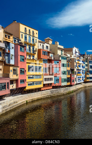 Colorful houses cling to the banks of River Onyar in Girona, Catalonia, Spain - Stock Photo
