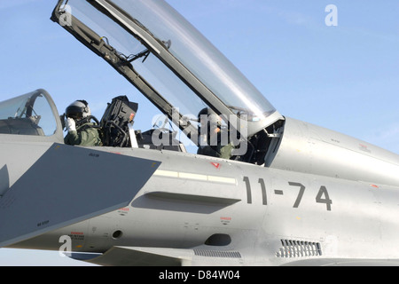 Pilots perform preflight checks in the cockpit of a Spanish Air Force Eurofighter Typhoon, Moron, Spain. - Stock Photo