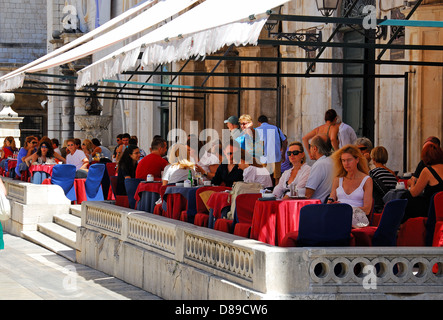 DUBROVNIK, CROATIA. A busy cafe terrace in the old walled town. - Stock Photo