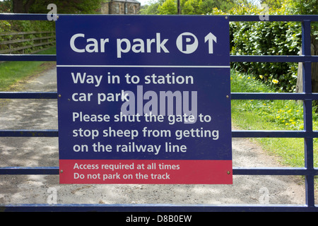 Danby station car park entrance, sign warning users to shut the gate to prevent sheep from getting on the railway - Stock Photo