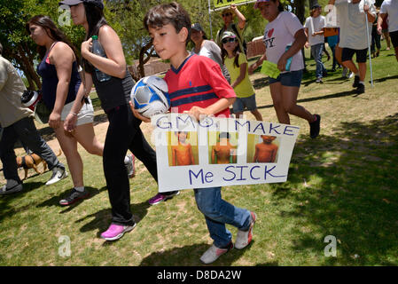 Tuscon, Arizona, USA. 25th May, 2013. Adryan Alavi, 7, joins about 1,000 protesters who participated in a march - Stock Photo