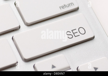 SEO button on the keyboard close-up - Stock Photo