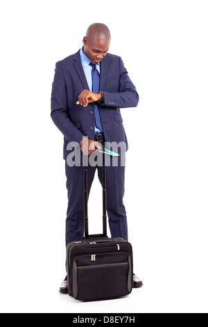 african american businessman travel with air ticket and trolley bag - Stock Photo