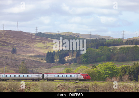 Class 390 Pendolino Virgin train at at Shap Wells, Cumbria, England, UK - Stock Photo