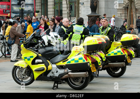 motorcycle paramedics relaxing with motorcycles, london, england - Stock Photo