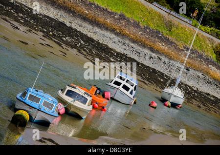 4 boats moor at Barmouth coast - Stock Photo