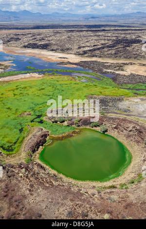 Crater lake adjacent to the Suguta river. Great Rift Valley. Kenya - Stock Photo