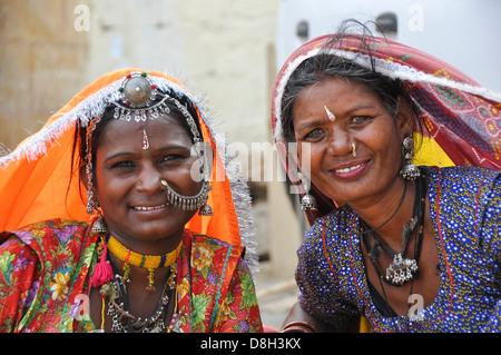 Rajasthani women in traditional sari dress and jewelry Jodhpur, Rajasthan, India - Stock Photo