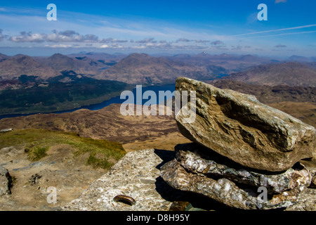 Looking from the summit trig point of Ben Lomond over Loch Lomond - Stock Photo