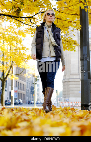 Young woman in autumn, promenade ,Berlin, Germany, Europe - Stock Photo