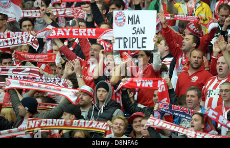 Berlin, Germany. 1st June, 2013. Supporters of Munich cheer for their team prior to the German DFB Cup final soccerh - Stock Photo