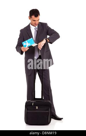 smart business traveler checking flight time - Stock Photo