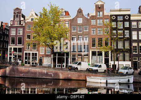 Historic houses along the Singel canal in the city of Amsterdam, Netherlands. - Stock Photo