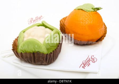 Orange and cauliflower designed sponge cakes from Betty's Café tearooms York North Yorkshire UK - Stock Photo