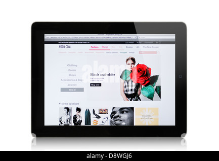 YOOX website on iPad -  Italian internet mail order retailer of men's and women's multibrand clothing and accessories - Stock Photo