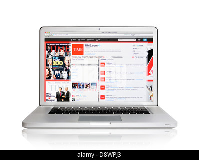 Laptop screen showing Time Magazine on Twitter website - Stock Photo