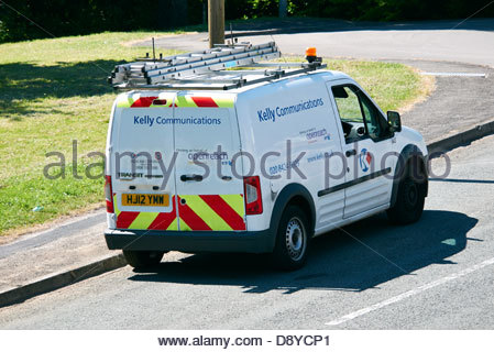kelly communications bt openreach white van parked at the kerbside near a junction - Stock Photo