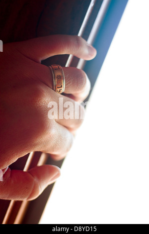 Hand with star of david wedding ring opens a door - Stock Photo