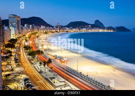 Dusk at Copacabana beach, Rio de Janeiro, Brazil - Stock Photo