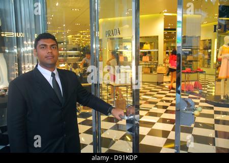 Singapore Orchard Road shopping Ion mall complex Asian man doorman Prada Italian fashion designer women's handbags - Stock Photo