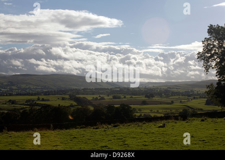 Storm clouds pass over Wensleydale on an Autumn evening from near Bolton Castle Yorkshire Dales England - Stock Photo