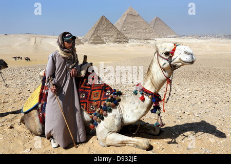 Camel Drivers in front of the Pyramids, Giza, Cairo, Egypt North Africa - Stock Photo