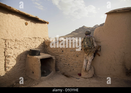 An Afghan Army soldier maintains security during a clearing operation part of Operation Nightmare June 6, 2013 in - Stock Photo