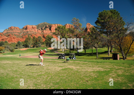Oak Creek Country Club golf course in Sedona, Arizona surrounded by red rock formations - Stock Photo