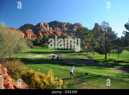 Oakcreek Country Club golf course in Sedona, Arizona surrounded by red rock formations - Stock Photo