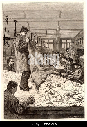 French postal service. Sacks of letters being emptied out in the sorting office at the main Post Office, rue du - Stock Photo