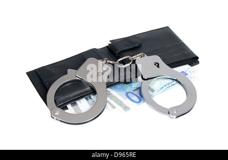 Euros and handcuffs - Stock Photo