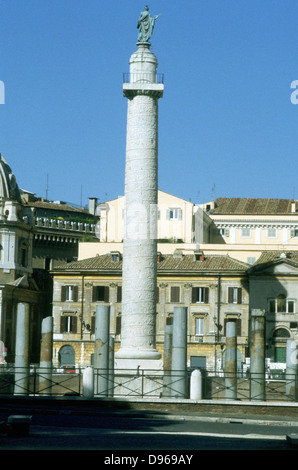 Trajan's column, Rome. Erected by emperor Trajan 106-113 and carved in low relief with narrative of his two campaigns - Stock Photo