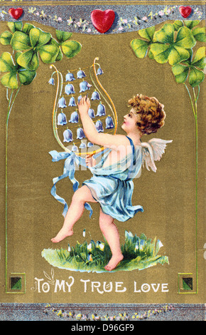 To My True Love, c1910. American Valentine  card.  Cupid dances on grass with naturalised Snowdrops and is playing - Stock Photo