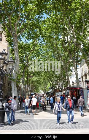 people walking down la rambla barcelona catalonia spain - Stock Photo
