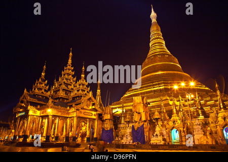 The main ZEDI of the SHWEDAGON PAYA or PAGODA which dates from 1485 is gilded every year - YANGON, MYANAMAR - Stock Photo