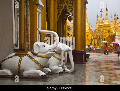 Good luck ELEPHANT STATUES at the SHWEDAGON PAYA or PAGODA which dates from 1485 - YANGON, MYANAMAR - Stock Photo