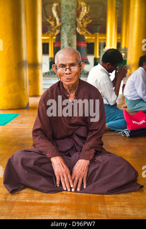 HOLY MAN at the SHWEDAGON PAYA or PAGODA which dates from 1485 - YANGON, MYANAMAR - Stock Photo
