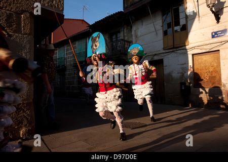 Galicia carnival. 'Cigarrons' marching through the city center. - Stock Photo