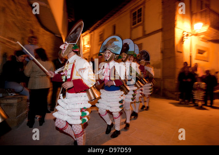 Galicia carnival. 'Peliqueiros' marching through the town during the start of celebrations - Stock Photo