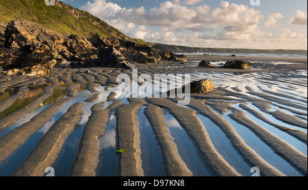 Patterns in the sand at low tide on Tregardock Beach, Cornwall, England. Summer (July) 2012. - Stock Photo