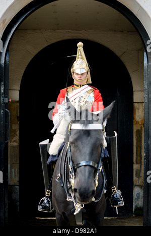LONDON, UK - A member of the elite British Arny regiment of the Life Guards, who are part of the Royal Household - Stock Photo
