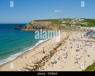Portreath beach in Cornwall UK.  Looking down from a cliff top on a sunny day. - Stock Photo