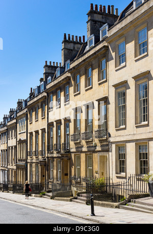 Row of old terraced houses in a street in Bath, Somerset, England, UK - Stock Photo
