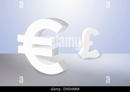 Euro and Pound signs on blue background - Stock Photo