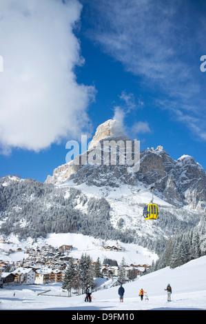 View of Corvara and gondola at the Alta Badia ski resort with Sassongher Mountain behind, Dolomites, South Tyrol, - Stock Photo