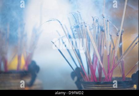 Incense burning at Shwedagon Paya (Shwedagon Pagoda), Yangon (Rangoon), Myanmar (Burma) - Stock Photo